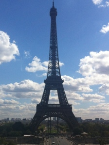Eiffel Tower against a blue and white spring sky