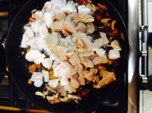 Cook the chicken with the bacon and mushrooms until the chicken begins to colour